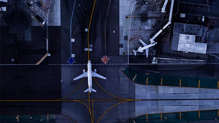 Aerial view of airport and planes.