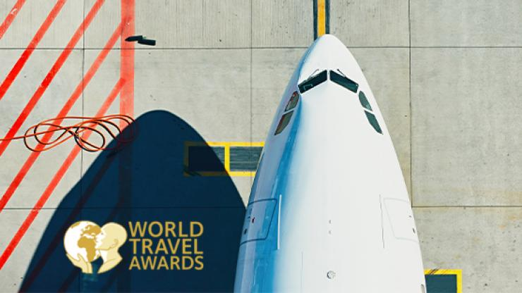 World Travel Awards logo with birds eye of plane nose.