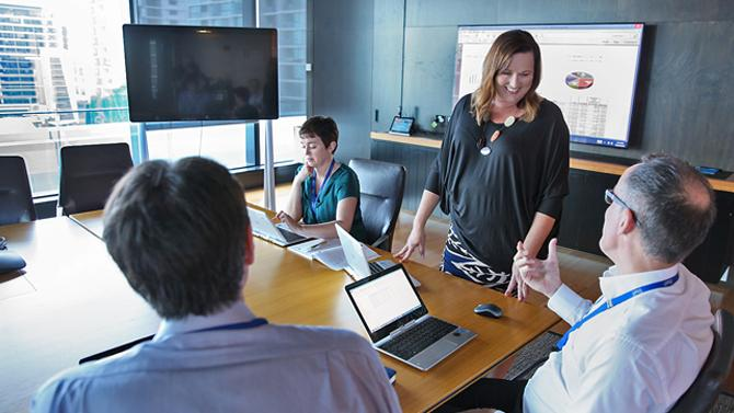 Bank of Queensland employees presenting in boardroom